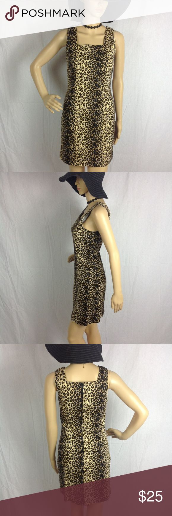 Vintage Blue Black Brown Leopard Print Mini Dress This dress is a thick stretchy bodycon like material. The material is a cotton spandex blend. No major flaws or wear to note. Please see all pictures. As always offers and bundles are welcome. Feel free to add one or more items to a bundle for a private discount offer!!!  Armpit to armpit is 15.25 inches across Waist is 13.5 inches across Hips are 15.75 inches across. Length is 32.75 inches. Vintage Blue Dresses Mini