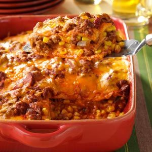 Enchilada casserole - layer like lasagna 1 pound ground beef (90% lean) 1 can (10 ounces) enchilada sauce 1 cup salsa 6 flour tortillas (10 inch) 2 cups fresh or frozen corn 4 cups (16 ounces) shredded cheddar cheese
