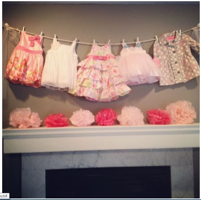 Baby Girl Shower ideas.  Bought new dresses and strung them from a rope.  Tank style dresses work best.