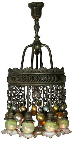 Louis Comfort Tiffany - (1848-1933) - Favrile Glass and Bronze Eight-Light Moorish Chandelier. Circa 1899-1920.