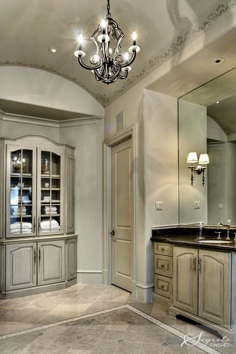 Love how the cabinets become furniture and the small detail on the ceiling to enhance the pretty barell!!