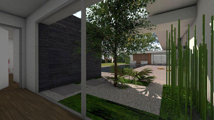 Atelier d'architecture Scénario - Maison contemporaine à patios et parement en pierres noires