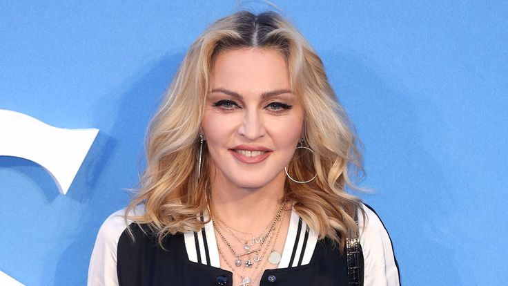 """Madonna Repeatedly Slams Donald Trump Says She's """"Ashamed to be an American"""" at Miami Fundraiser  The musician also kissed Ariana Grande and teased ex-husband Sean Penn who crawled through her legs at one point as the two tried to coerce the audience to bid higher.  read more"""