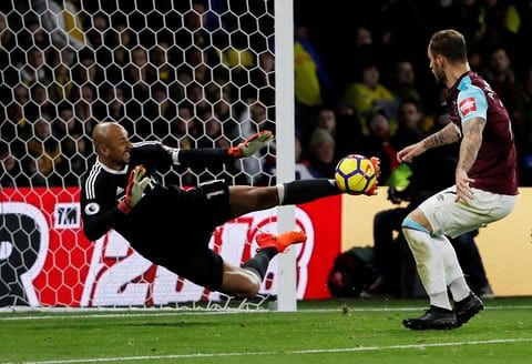Watford's Heurelho Gomes makes a save from a shot by West Ham's Marko Arnautovic. Watford took control of the game and won 2-0 at Vicarage Road