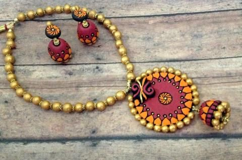✪✪..Try thisRed and Orange Terracotta Chakra #JhumkaPendantSet. It consists of Chakra shaped #Jhumkaearrings and pendant Set!!!!! ..✪✪