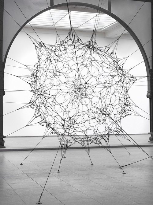 Tomas Saraceno.Argentinian artist was trained as an architect, and works with chemists, engineers, and astrophysicists (for starters) to create his beautiful sculptures, many of which are created from elastic cords and acrylic glass.