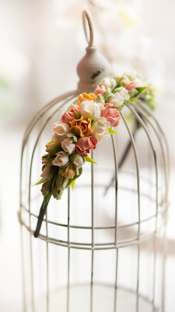 Very gentle and romantic wedding wreath with flowers freesia and cascade buds . All the flowers made entirely out of the hands cold porcelain, after