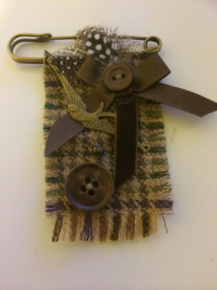 Kilt pin tweed brooch