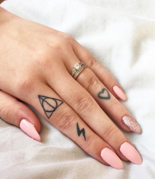 Here for deathly hallows and hearts deathly hallows for Finger tattoo ideas