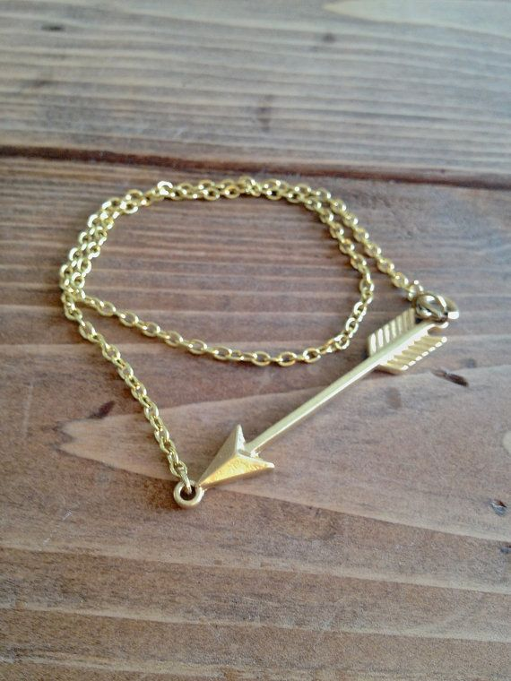 I have a sliver necklace that looks exactly this.   Gold arrow bracelet by xoTaylorMadeJewelry on Etsy