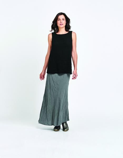 TheFLAX Layer Tankis a roomy boat collar tank with a modest A-line shape. Made in a Black Marled Gauze fabric, this tank has a puckered texture that is just s