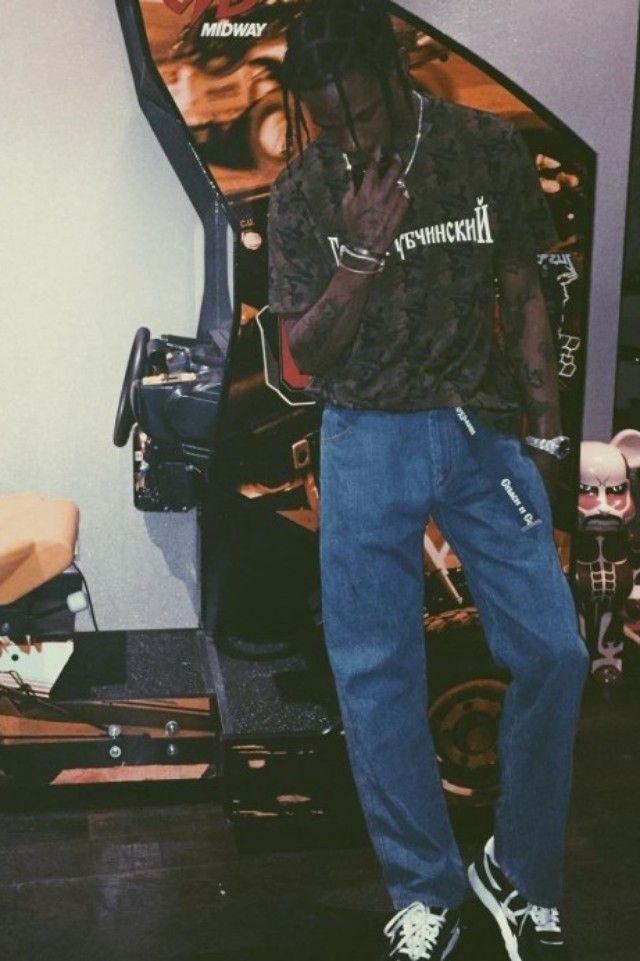 Travis Scott wearing  Gosha Rubchinskiy FW16 Jeans, Gosha Rubchinskiy FW16 Camo Print Tee