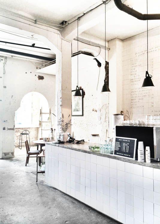 kitchen: industrial commercial / concrete floor + square white tiles
