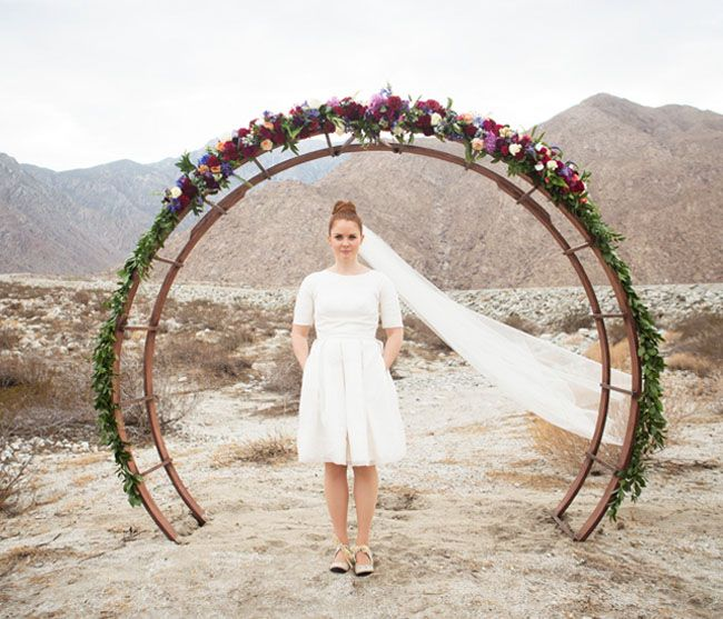 mid-century modern ceremony arch with flowers