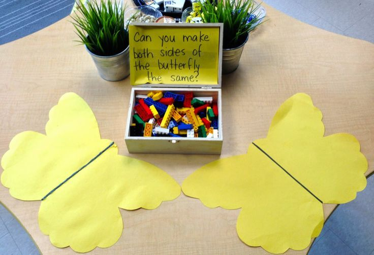 Symmetry provocation using Lego-- I would probably use glass florist beads and twigs, though