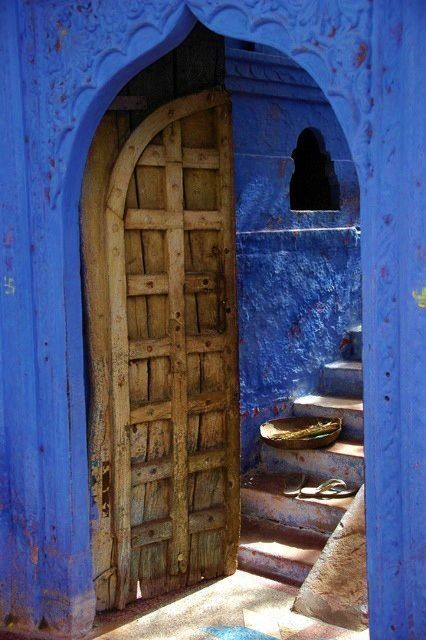 Wooden doorway in blue wall (probably north africa) - (GypsyPurpleLoves)