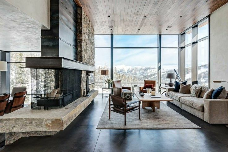 A modern home overlooking gorgeous snow capped mountains. Isn't the view breathtaking?