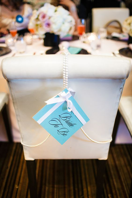 Add a touch of Tiffany blue on the chair for a Breakfast at Tiffany's bridal shower.