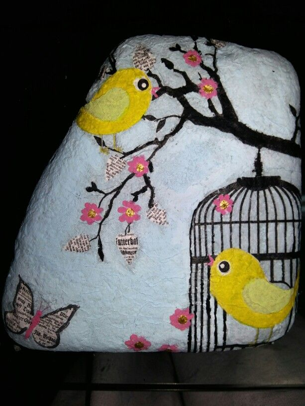 """Yellow birds"" decoupage on a rock"