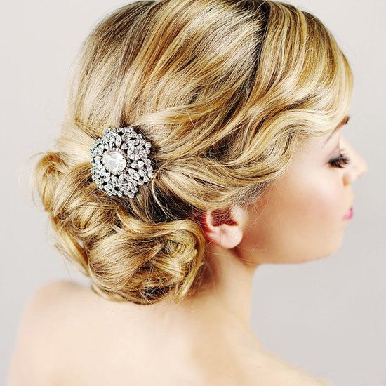 Brooch the Subject: Here's one of the more creative styling ideas we've seen pinned: this cool Elsa Corsi brooch used as a focal point for an elegant bridal chignon.