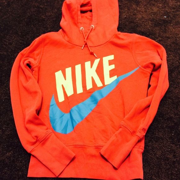 Nike pullover hoodie Very comfortable & bright.. One of my favorite, but it's time to let go Nike Jackets & Coats