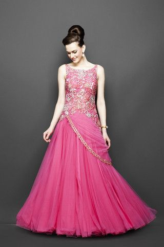 This pink color Indo Western bridal gown comes with the heavily embroidered bodice, with a low back. There is a stylish belt that runs across from the front to the back. Customization accepted for thi
