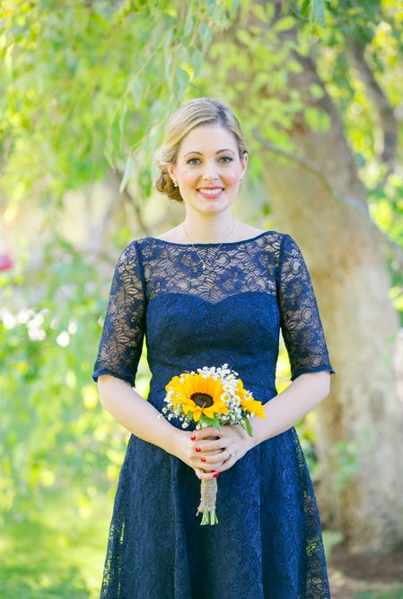 Blue lace bridesmaids dress and sunflower bouquet!
