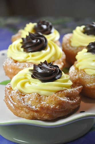 The richly delicious Italian dessert classic of Zeppole di San Giuseppe (Fried Pastry with Lemon Cream Filling, Topped with Chocolate Ganache). #food #Italian #Italy #pastry #lemon #chocolate #dessert