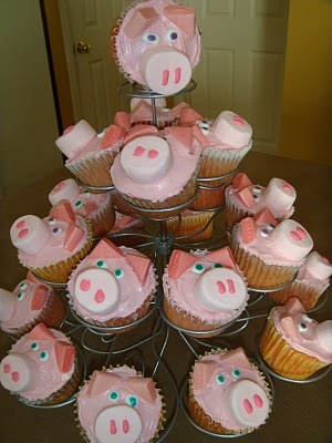 These are pink cupcakes - usually strawberry flavored.  The pink funfetti icing is the perfect color and you don't have to mess with food coloring. The ears are star burst candies cut in half and the noses are strawberry marshmallows cut in half. I use the little tubes of colored icing to make the eyes and nostrils.