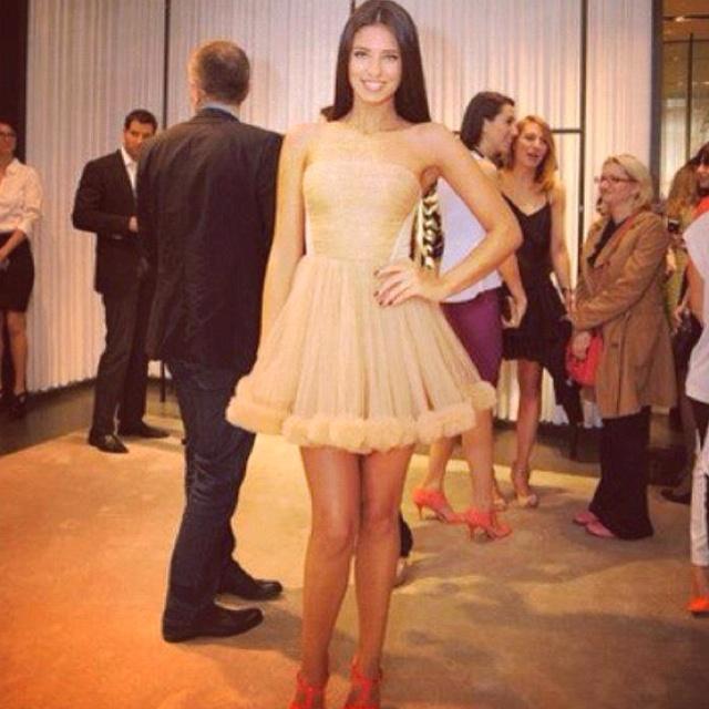 Antonia wearing an MHL dress