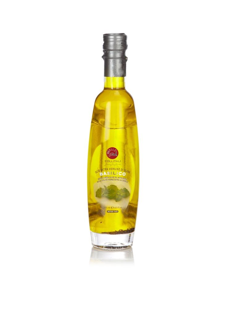 Collítali extra virgine olijfolie metbasilicum in een sierlijke glazen fles.