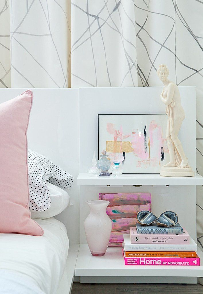 While showing off a few of your favorite reads is a great way to add character to your bedroom, going overboard is unstylish and just plain dangerous! Photo by Ashley Capp via Style Me Pretty