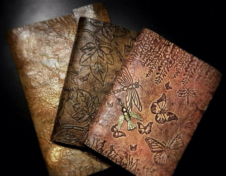 Sheena Douglass created these books using her new nature embossing folders and by making faux leather from Kraftcard and glycerine. Checkout her YouTube video. Love this technique :)