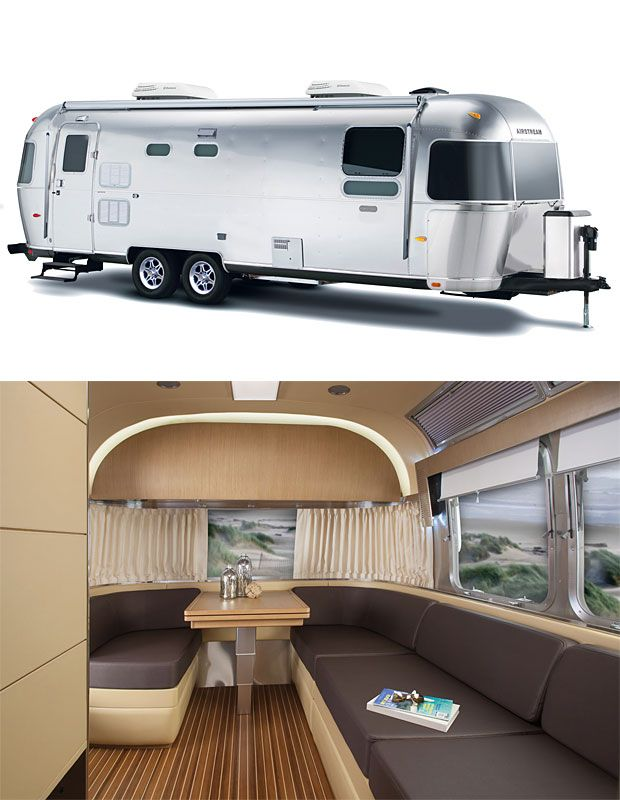 Airstream Land Yacht ,  With design elements and decor borrowed from yachts of the ocean-going variety, Airstream's new 28' Land Yacht camper is pretty much a luxury liner on wheels that offers floor-to-ceiling woodgrain and nautical trimmings inside its shining, metal exterior.