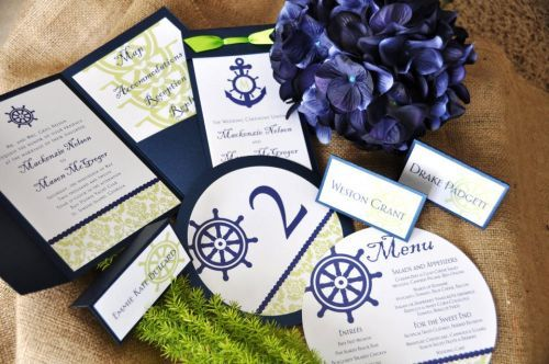 Beautiful navy and green wedding stationery set.