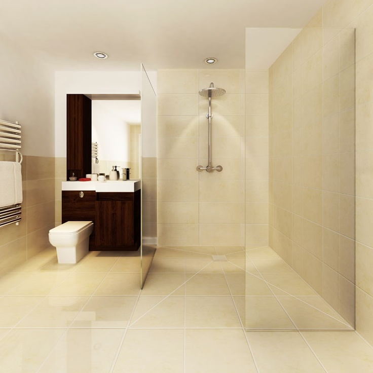A large wet room showering area with two glass panels to contain the water.