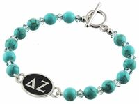 Swarovski Turquoise Beads, and Swarovski Crystals are combined to create our Delta Zeta Bracelet. The Sorority bracelet top is cast in solid sterling silver and hand finished to achieve maximum detail. The Turquoise beads are Swarovski dyed Howlite with a bright Turquoise color and a hint of natural looking matrix. The accent beads are genuine Swarovski Crystal in a clean Aqua color. Designed by sorority sisters for a fresh clean look. Made in the U.S.A.Metal: Sterling SilverBracele