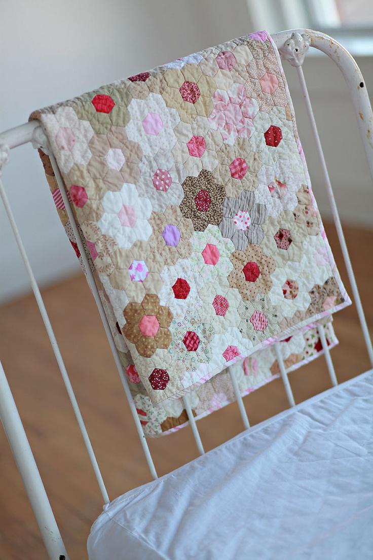 Strawberries and Cream flower garden hexie quilt. .