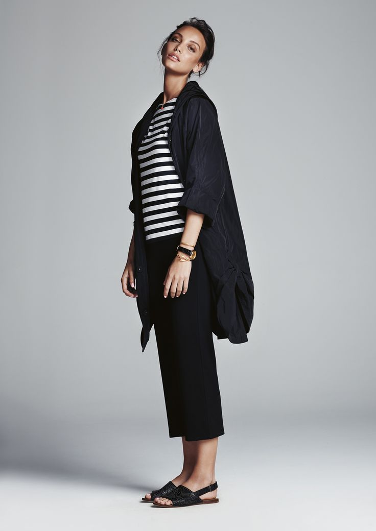 Black two way tab raincoat, icon stripe boat neck top and black 3/4 pant.