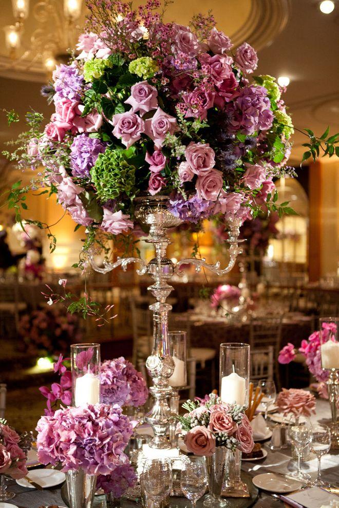 wow...wonderful purple spring inspired centerpiece on tall silver candelabras