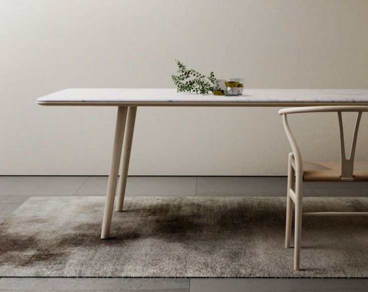 The Arin Table from French marble company Retegui has a wafer-thin Carrara marble top made possible via precision milling and bonding techniques. Retegui Marble Topped Table | Remodelista