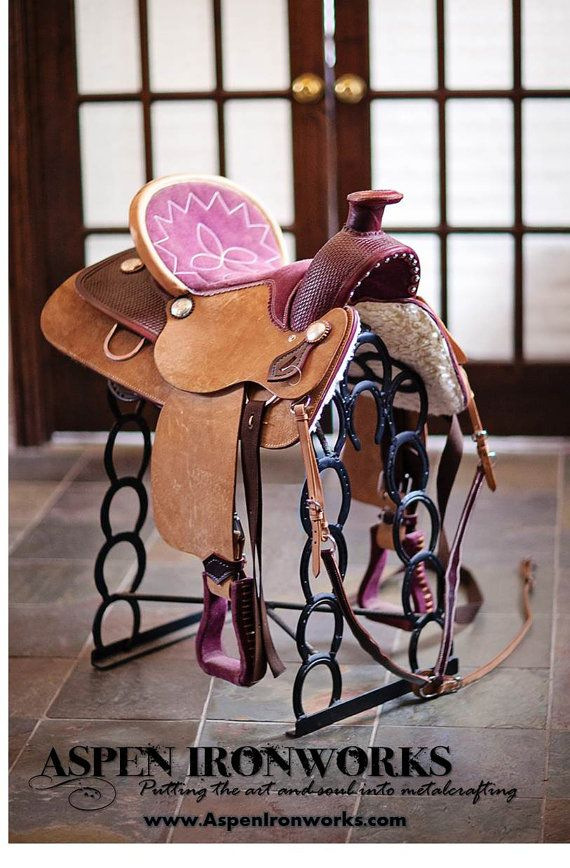 Saddle up, Pardner! Heres the perfect Christmas gift for the cowboy, cowgirl or horseperson in your life. John Waynes saddle rack holds an adult