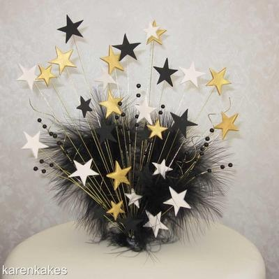 gold cream amp black star cake topper with marabou feather