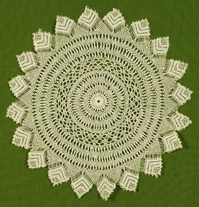 Armenian lace doily (circa 1965) with pointed edge and round form