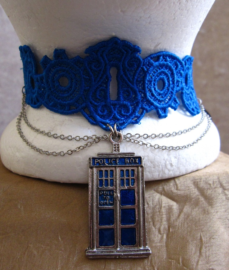 This Doctor Who inspired choker is made of a steampunk-esque cogs and keyhole patterned lace in blue, matching the blue enamel on the TARDIS charm. It is accented in a double drape of silver chain on either side of the TARDIS. The choker ties in the back with a black velvet ribbon. $32.00