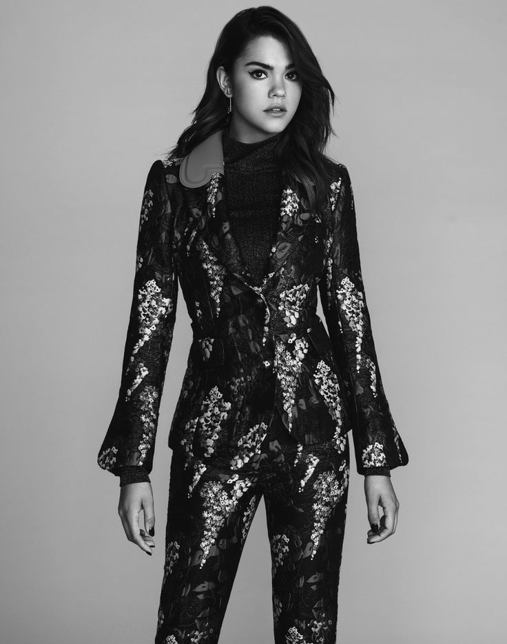 Maia Mitchell in black and white wearing a floral suit.