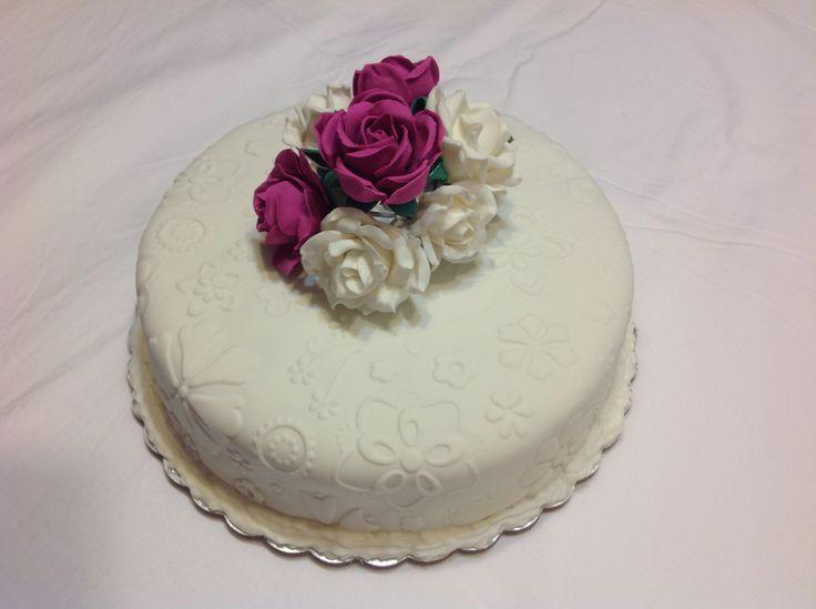 Cherry & Sultana butter cake, chocolate ganache and embossed vanilla fondant. Deep purple & white rose bouquet.