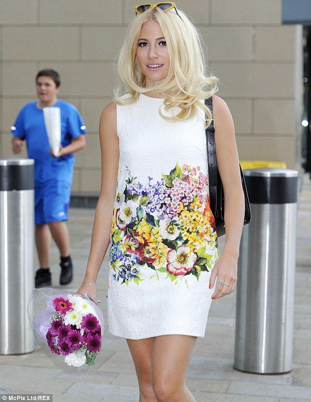 Pixie Lott flashes pins in short floral dress ahead of TV appearance #dailymail