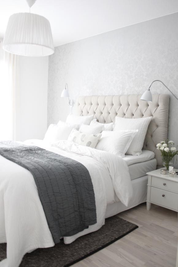 white & grey sophisticated bedroom with a relaxing colour scheme