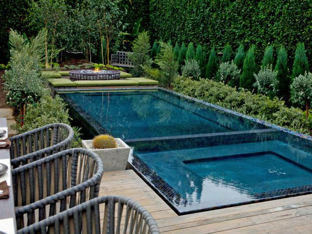 Love the verticality of the greenery on the walls. Gorgeous. Really makes the blue pool pop.
